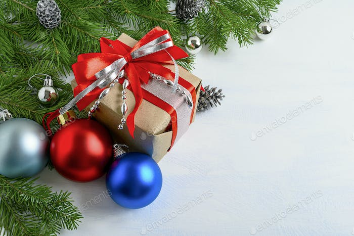 Christmas background with gift box, white, blue, red balls