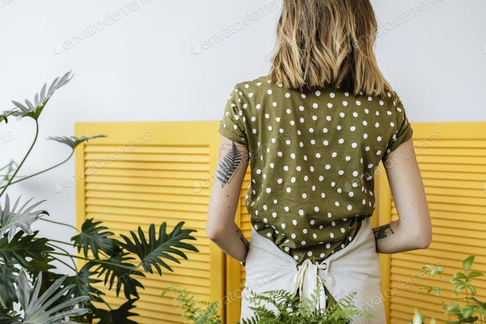 Woman with a botanical tattoo