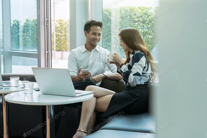Happy Asian Beautiful young business woman and handsome businessman