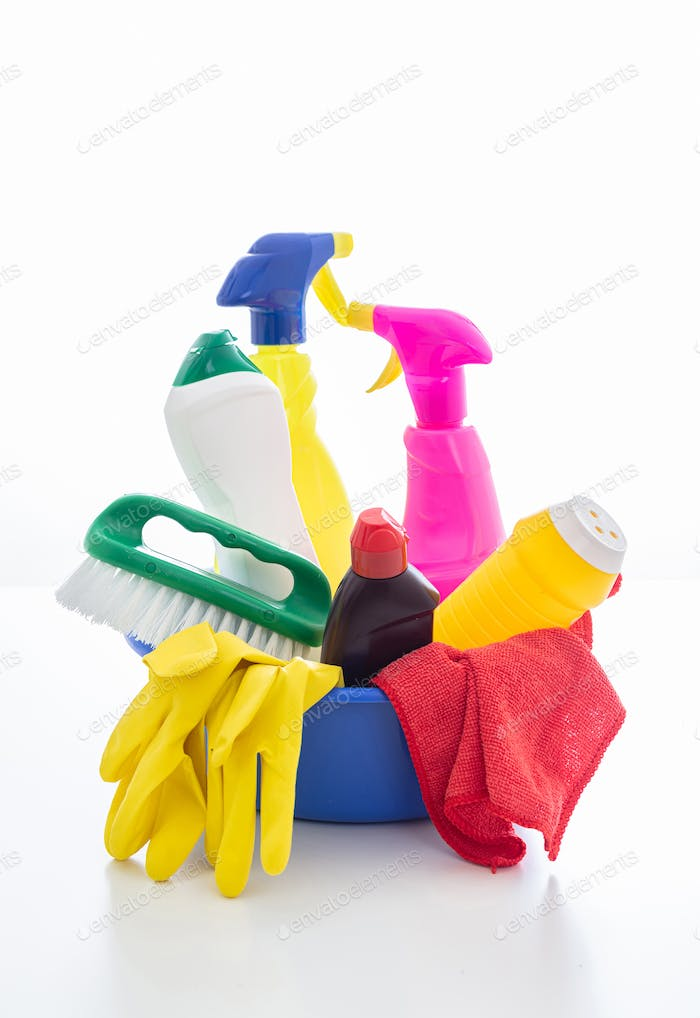 Cleaning supplies in a blue bowl isolated against white background.