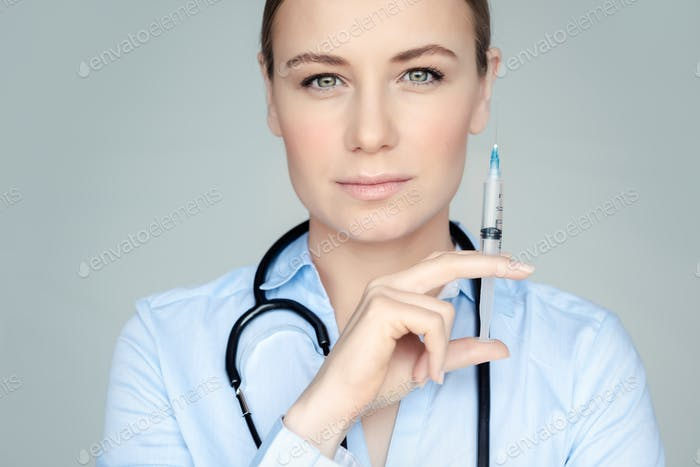 Serious doctor with syringe