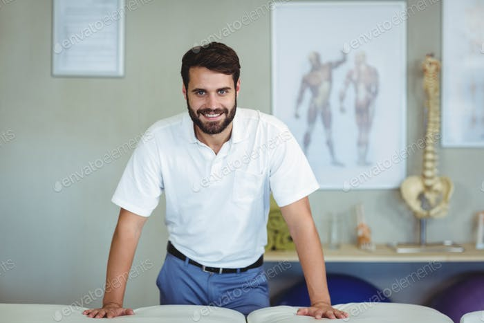 Portrait of physiotherapist standing in clinic
