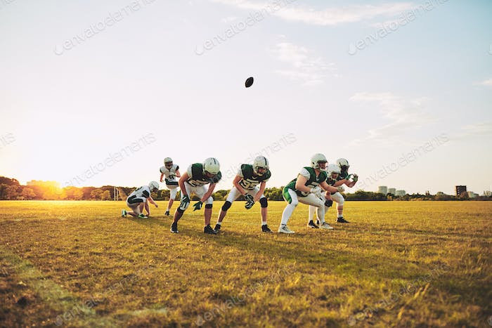 American football team practicing place kicking on a sports field
