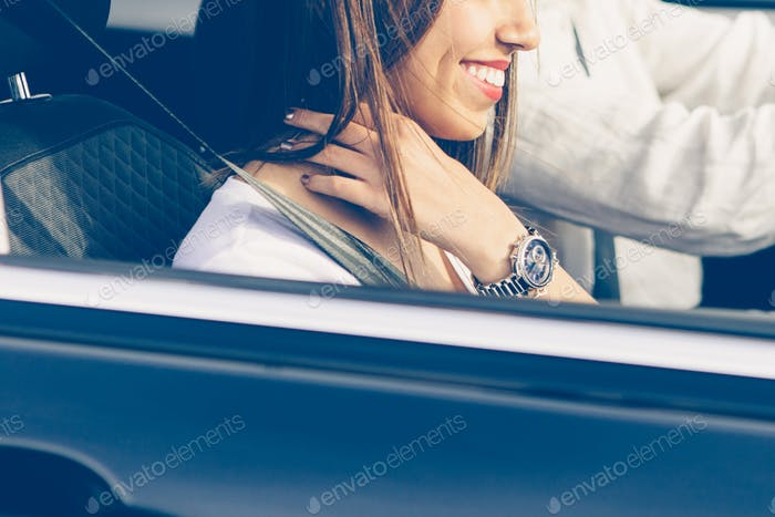 Girl using the car seat belt