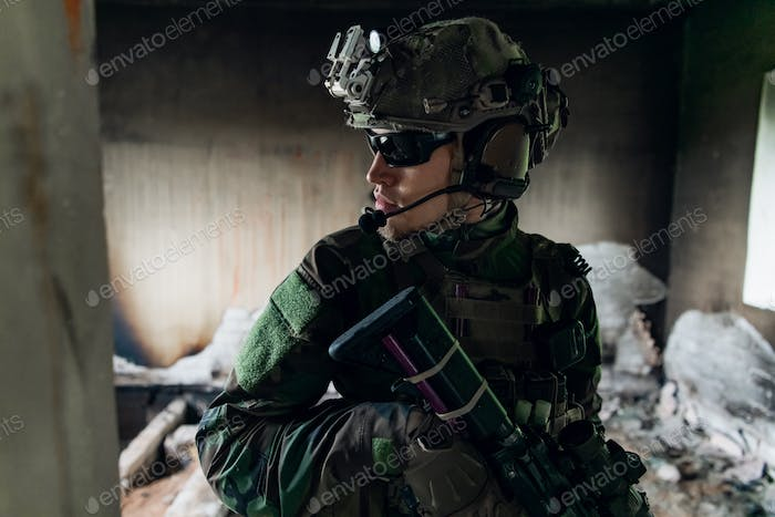 Military men with arms defending the building. Soldier stand guard securing territory looking around