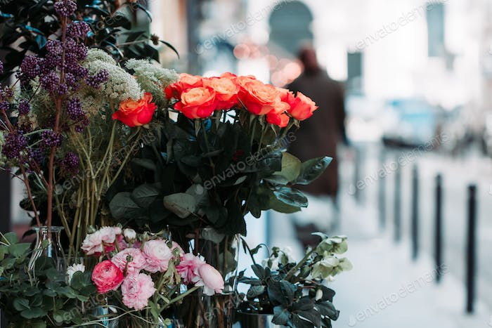 View of a bouquet of scarlet roses in a street flower shop in Paris, France.