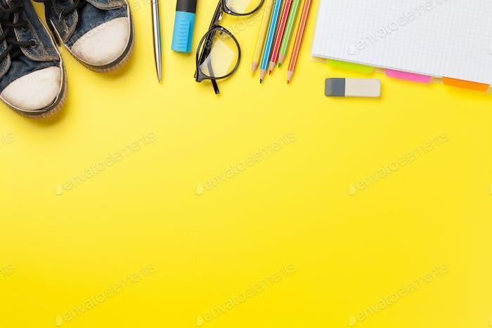 Yellow backdrop with school supplies