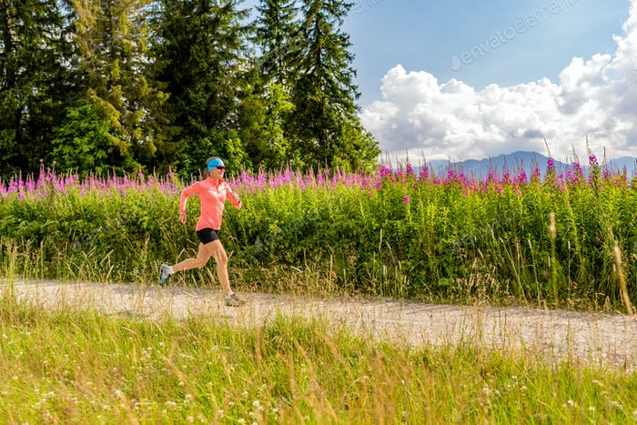 Woman athlete trail running in mountains, sport and fitness