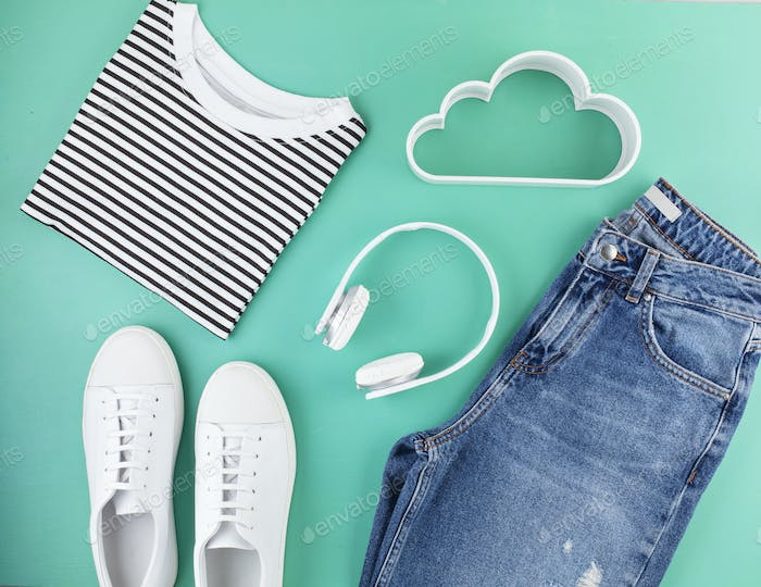 Flat lay with girls spring summer accessories over aquamarine background