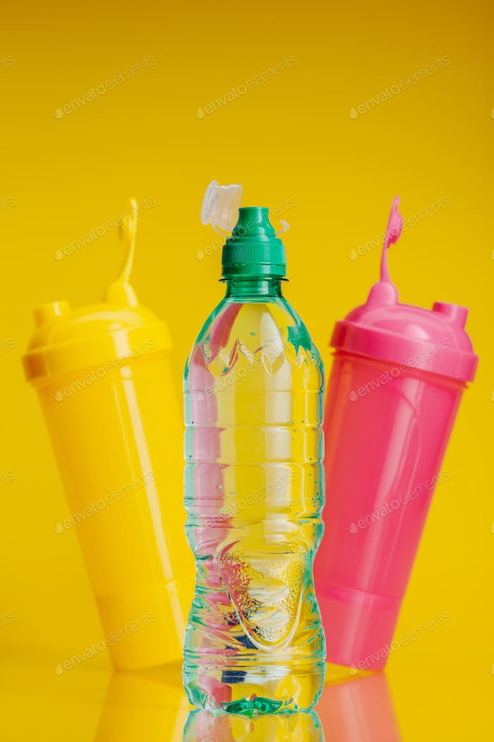 Pure water in plastic bottle on bright yellow background
