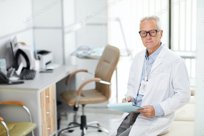 Mature Doctor Posing in Office