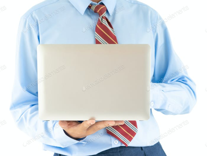 Businessman holding a laptop with clipping path 9