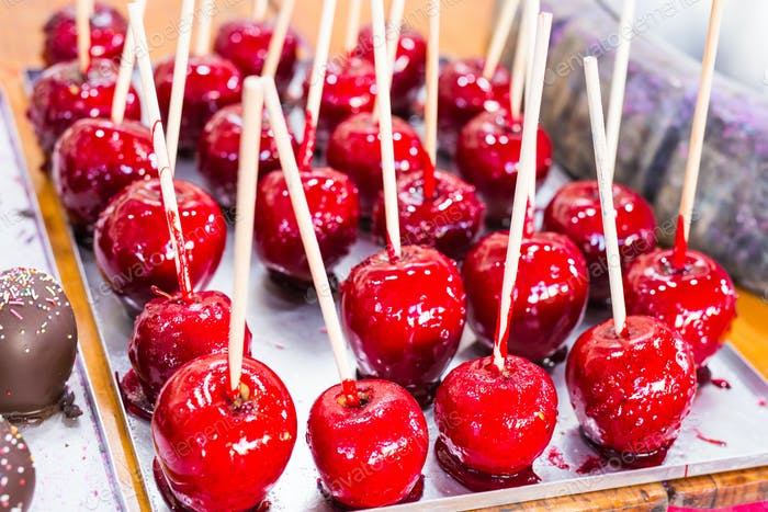 Red apples on a stick in caramel yum yum