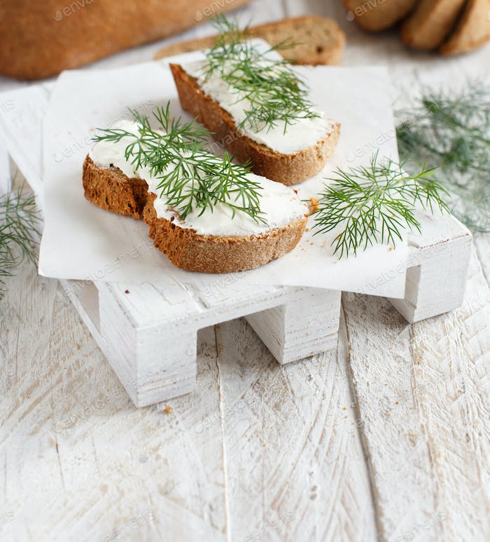 Sandwiches with cream cheese and fresh dill