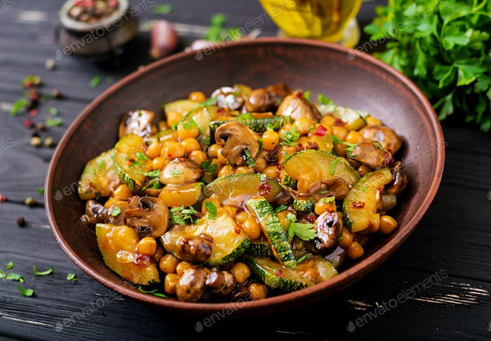 Vegan stir fry of mushrooms, zucchini and chickpea