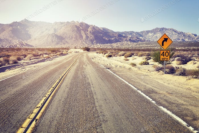 Desert highway with speed limit sign, USA.