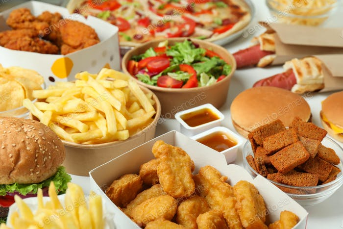 Concept of fast food on white background