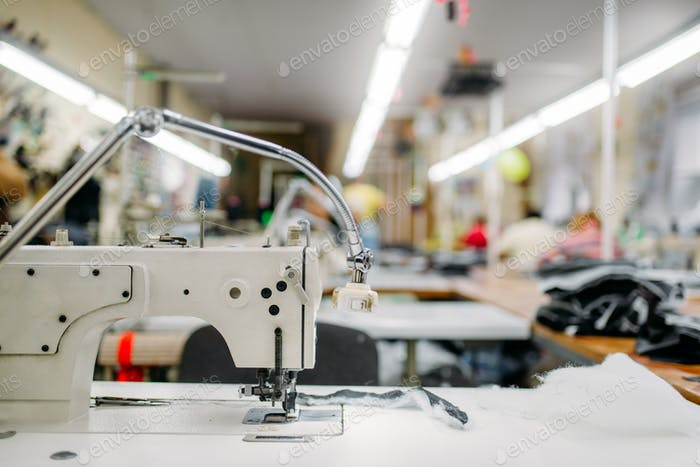 Sewing machine on clothing fabric, nobody