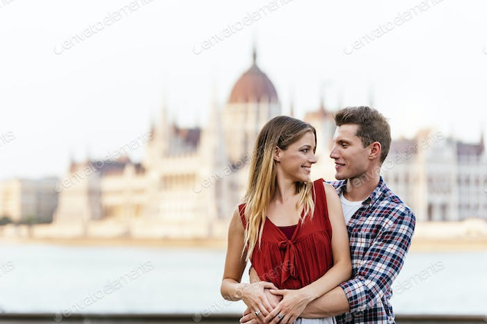 Young loving couple hugging in Budapest City.