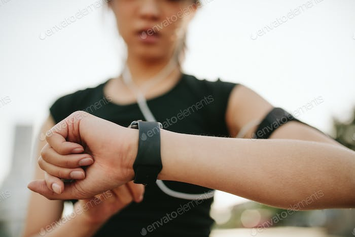 Fitness female monitoring her performance on smartwatch