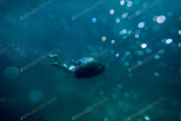 Unterwasser-Roller Seabob nicht identifizierte Mann tauchen
