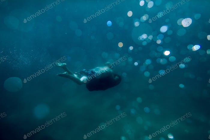 underwater scooter seabob unidentified man dive