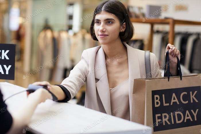 Young Woman Buying Clothes in Boutique