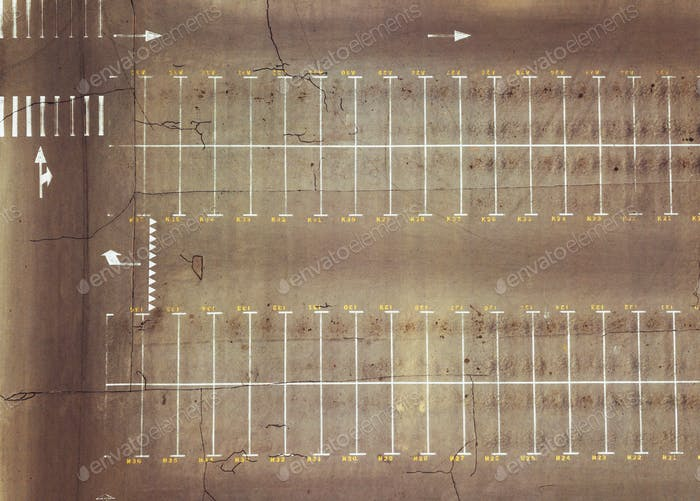 Aerial view from the drone of an empty parking lot with pointing markings. Top view