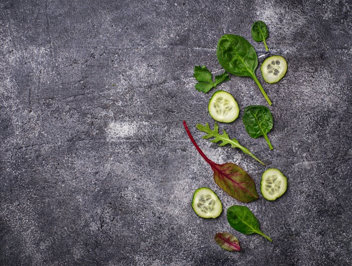 Sliced cucumber and salad mix.