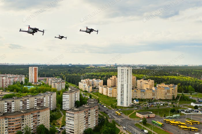Drones flying over the houses of the city of Minsk. Urban landscape with drones flying over it