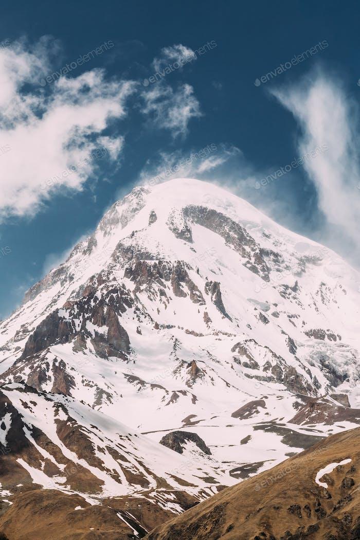 Georgia. Peak Of Mount Kazbek Covered With Snow