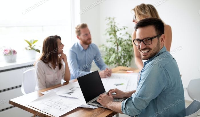 Group of business people working and communicating together in creative office