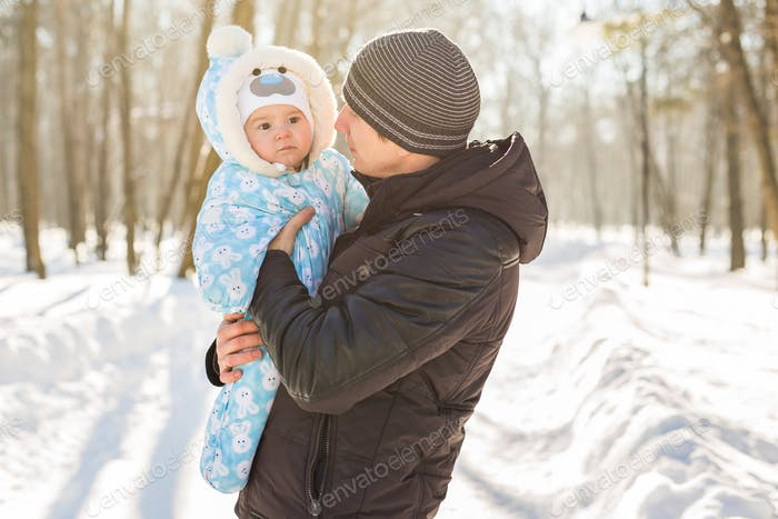Happy father with his baby on winter weekend