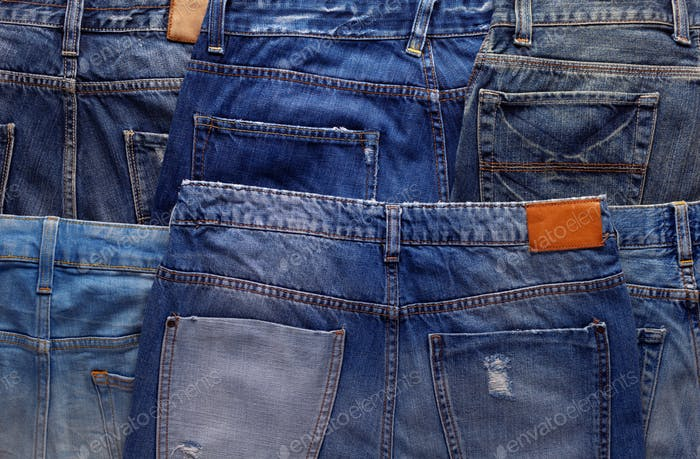 Blue jeans denim pocket background texture. Jeans heap
