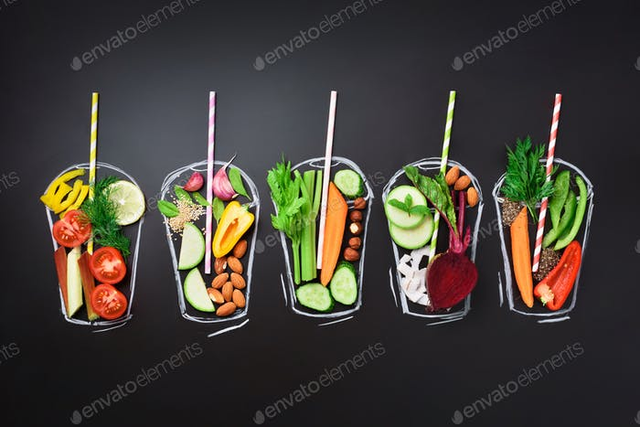 Food ingredients for blending smoothie or juice on painted glass over black chalkboard. Top view