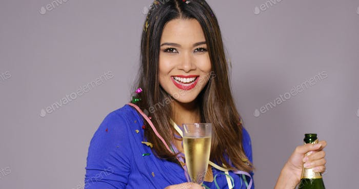 Gorgeous young woman celebrating with champagne