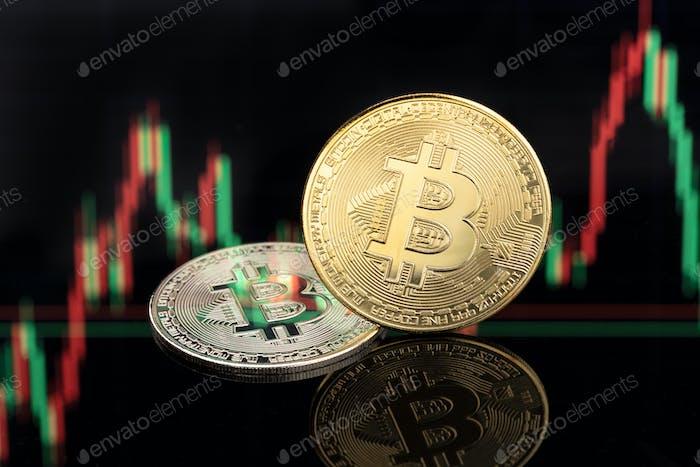 Monedas Bitcoin en el fondo del gráfico de acciones