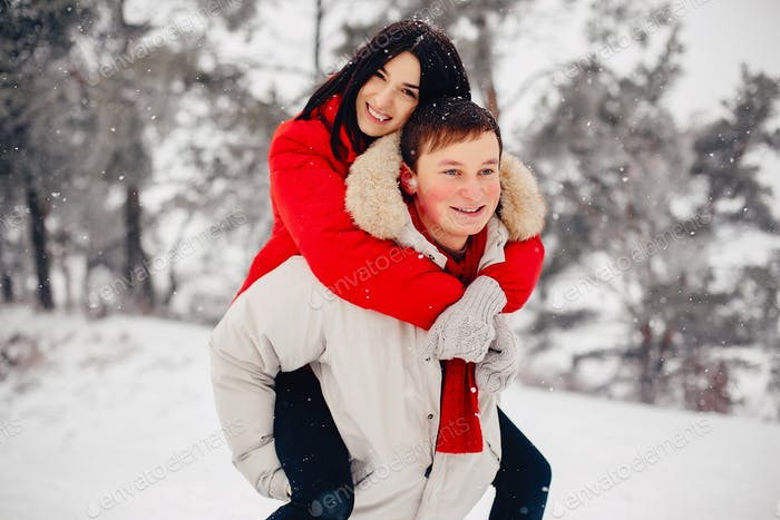Loving couple walking in a winter park