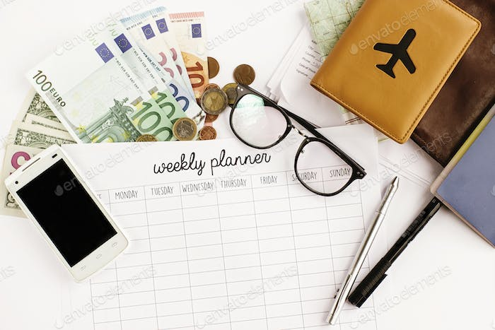 passport money phone with empty screen weekly planner map and glasses