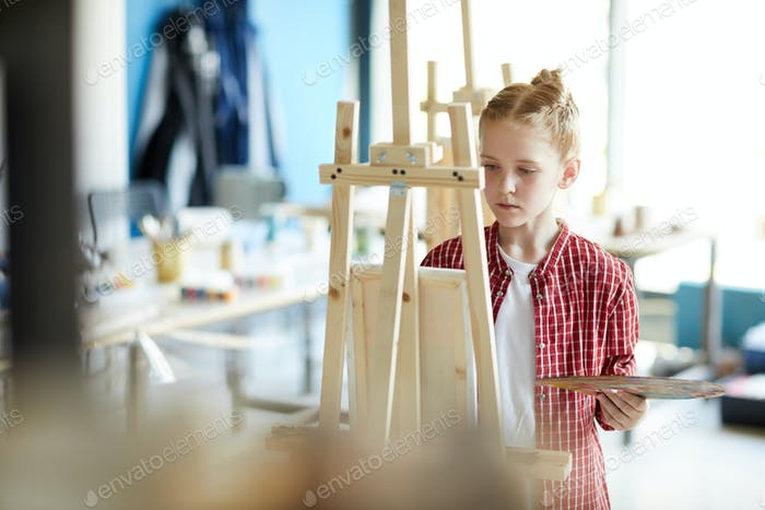 Girl in front of easel
