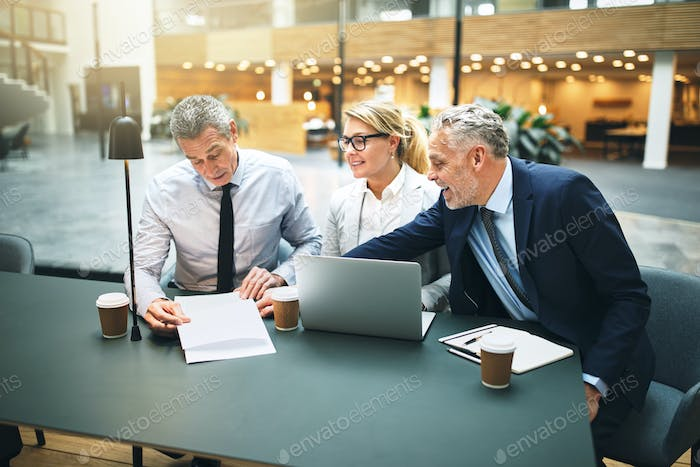 Mature executives meeting in the lobby of an office building
