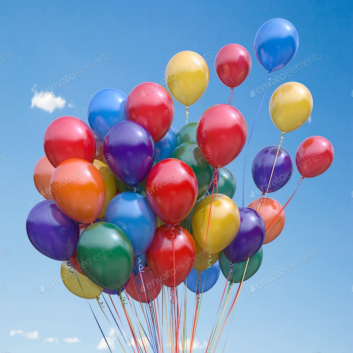 Colorful balloons bunch  floating in the sky.