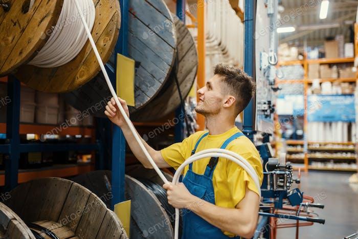Male builder choosing wires in hardware store