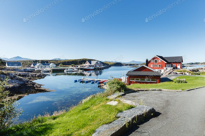 view on norwegian fjord with houses along coastline