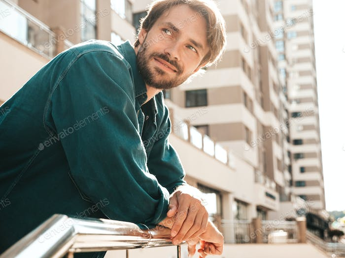 Portrait of handsome man posing outdoors