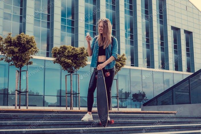 Smiling blond female posing on steps.