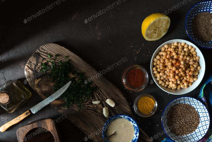 Ingredients for cooking falafel, chickpeas, tahini and spices free space