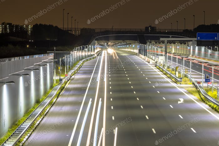 Motorway with entrance of tunnel at night