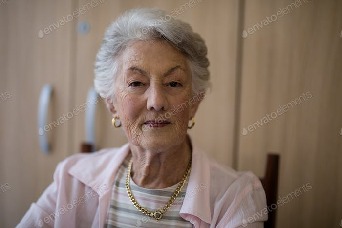 Portrait of senior woman sitting on chair