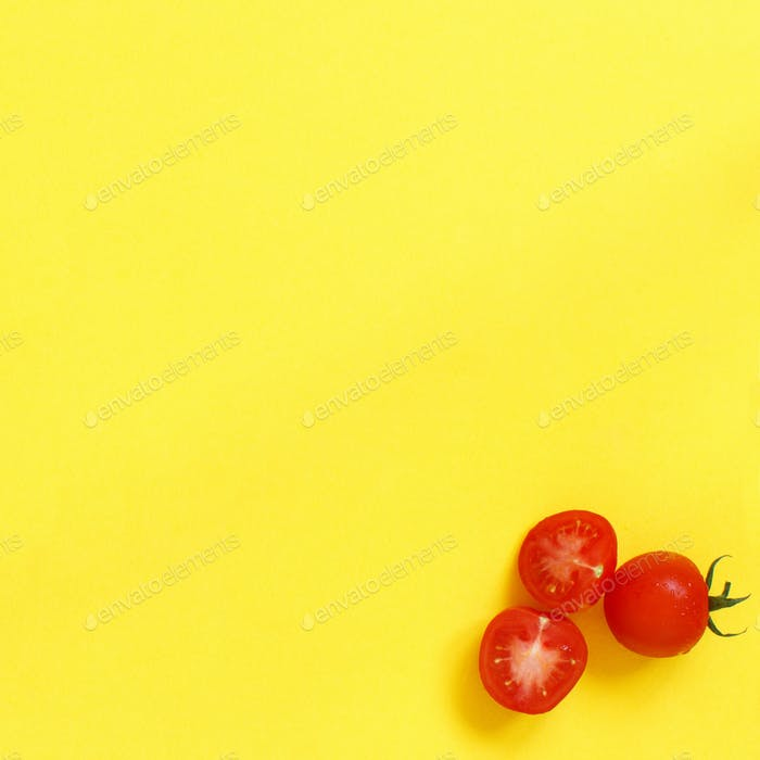 Cherry tomatoes on a yellow background